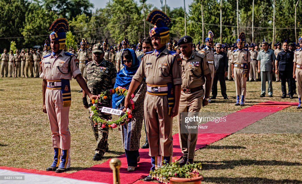 Mehbooba Mufti, Chief Minister of Jammu and Kashmir lays a wreath on the the coffins containing bodies of Indian Paramilitary soldiers of Central Reserve Police Force (CRPF) during a wreath-laying ceremony of eight CRPF soldiers killed in an ambush on June 26, 2016 in Srinagar, the summer capital of Indian Administered Kashmir, Indian. Eight Indian Central Reserve Police Force troopers were killed and another twenty critically wounded on Saturday after pro freedom rebels ambushed a paramilitary convoy on the Srinagar-Jammu highway near Pampore in Jammu and Kashmir's Pulwom district, police said. The firing was returned and two rebels were killed in the retaliatory action by the CRPF troopers. A wreath-laying ceremony was held today by the CRPF for their killed comrades.
