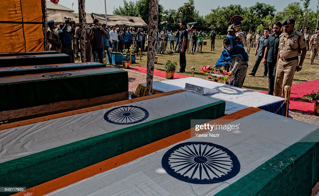 Mehbooba Mufti, Chief Minister of Jammu and Kashmir lays wreath on the the coffins containing bodies of Indian Paramilitary soldiers of Central Reserve Police Force (CRPF) during a wreath-laying ceremony of eight CRPF soldiers killed in an ambush on June 26, 2016 in Srinagar, the summer capital of Indian Administered Kashmir, Indian. Eight Indian Central Reserve Police Force troopers were killed and another twenty critically wounded on Saturday after pro freedom rebels ambushed a paramilitary convoy on the Srinagar-Jammu highway near Pampore in Jammu and Kashmir's Pulwom district, police said. The firing was returned and two rebels were killed in the retaliatory action by the CRPF troopers. A wreath-laying ceremony was held today by the CRPF for their killed comrades.