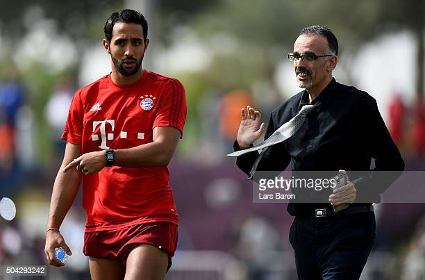 Mehdi Benatia is seen with a fan during a training session at day five of the Bayern Muenchen training camp at Aspire Academy on January 10 2016 in...