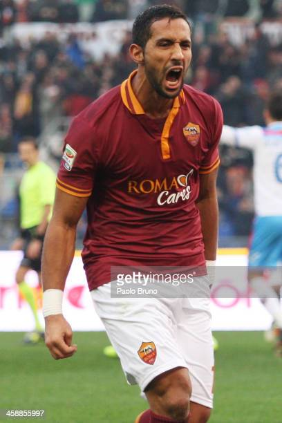 Mehdi Benatia of AS Roma celebrates after scoring the third team's goal during the Serie A match between AS Roma and Calcio Catania at Stadio...