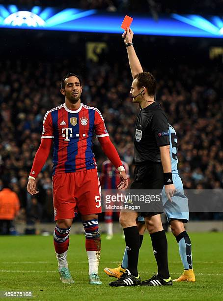 Mehdi Benatia of Bayern Muenchen is shown the red card by referee Pavel Kralovec of the Czech Republic during the UEFA Champions League Group E match...