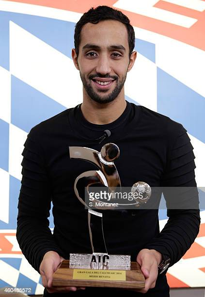 Mehdi Benatia of Bayern Muenchen poses with the trophy honored as member of Serie Ateam of the year 2014 at Bayern's training ground Saebener Strasse...