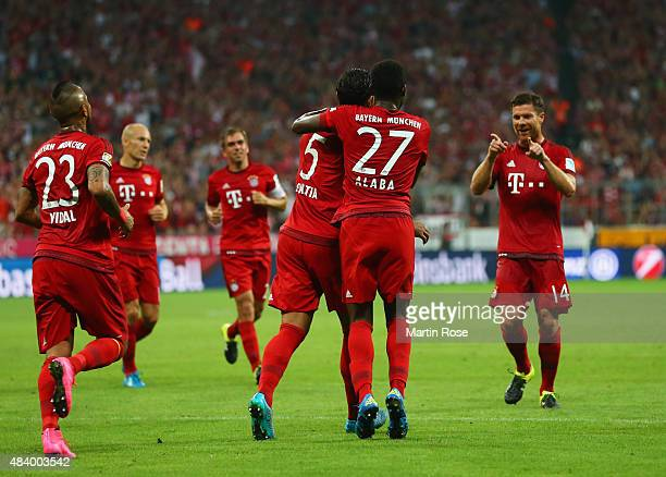 Mehdi Benatia of Bayern Munich celebrates with team mates David Alaba and goal provider Xabi Alonso as he scores their first goal during the...