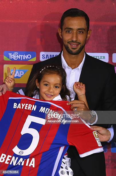 Mehdi Benatia of FC Bayern Muenchen pose with his daughter Lina afte a press conference at Bayern Muenchen's headquarter Saebener Strasse on August...