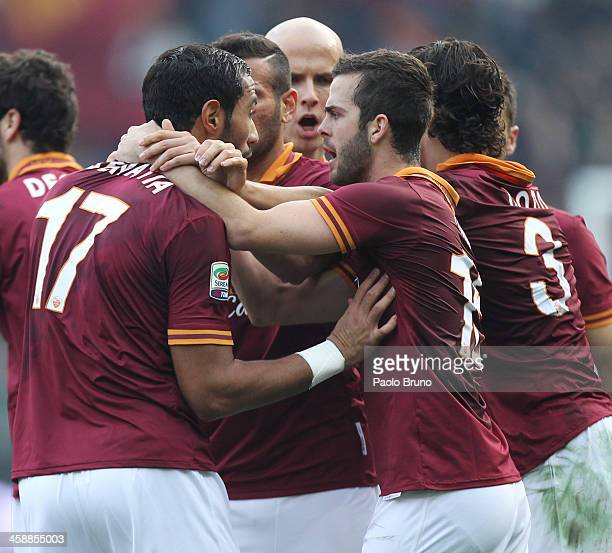 Mehdi Benatia with his teammates of AS Roma celebrates after scoring the opening goal during the Serie A match between AS Roma and Calcio Catania at...