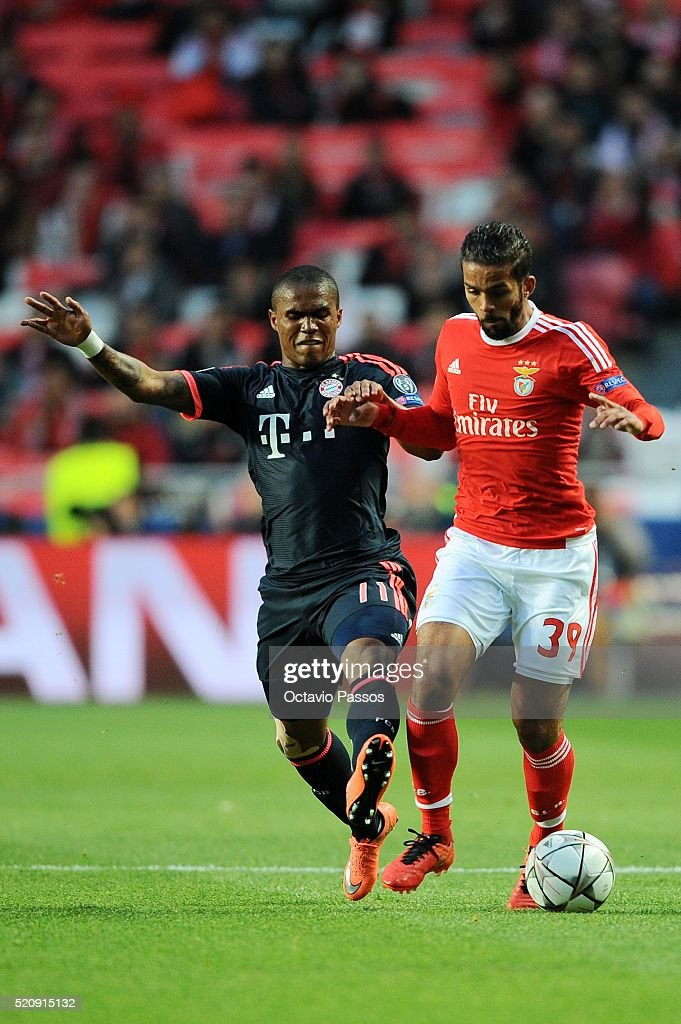 Mehdi Carcela Gonzalez of SL Benfica challenges <a gi-track='captionPersonalityLinkClicked' href=/galleries/search?phrase=Douglas+Costa+-+Soccer+Forward+-+Born+1990&family=editorial&specificpeople=5672410 ng-click='$event.stopPropagation()'>Douglas Costa</a> of FC Bayern Muenchen during the UEFA Champions league Quarter Final Second Leg match between SL Benfica and FC Bayern Muenchen at Estadio da Luz on April 13, 2016 in Lisbon, Portugal.
