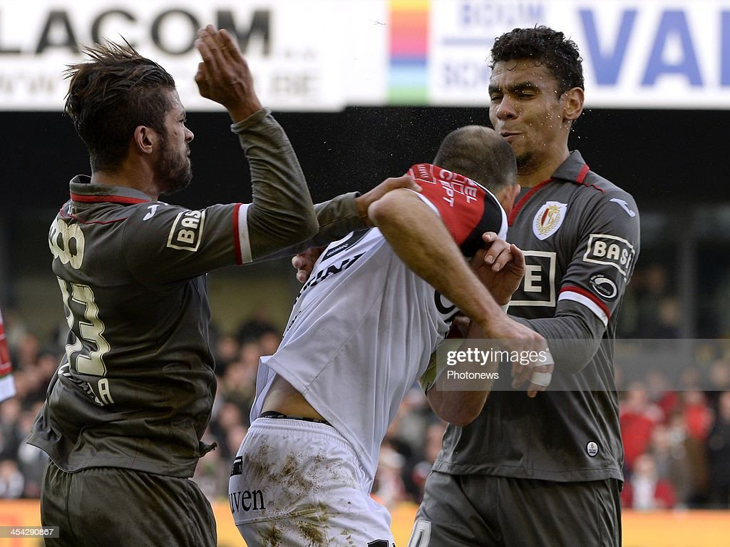 Mehdi Carcela of Standard Liege and Bjorn Ruytinx of OHL pictured during the Jupiler League between OHL vs Standard of Liege at Den Dreef stadium on December 8, 2013 in Leuven, Belgium.