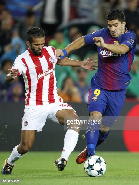 Mehdi CarcelaGonzalez of Olympiacos Luis Suarez of FC Barcelona during the UEFA Champions League group D match between FC Barcelona and Olympiacos on...
