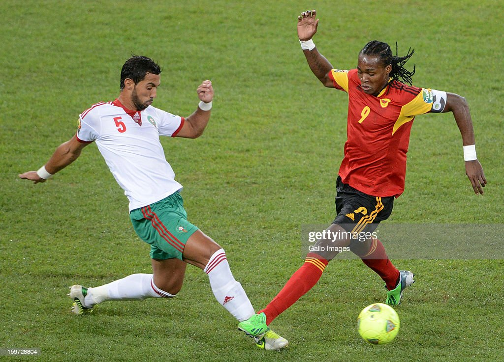 Mehdi El Mouttaqui of Morocco tackles Mateus Alberto of Angola during the 2013 Orange African Cup of Nations match between Angola and Morocco at the National Stadium on January 19, 2013 in Johannesburg, South Africa.