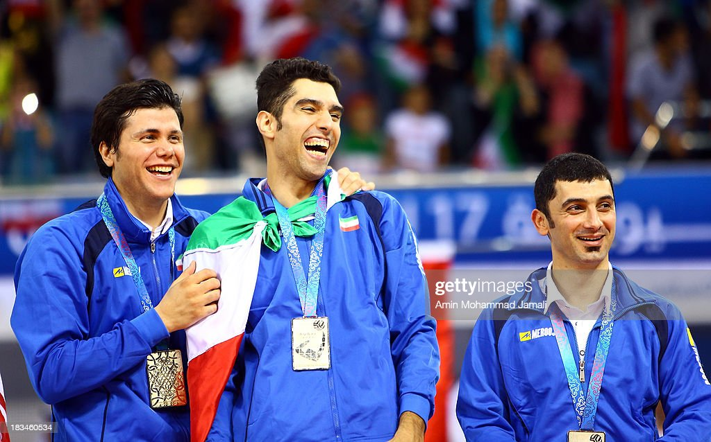 Mehdi Mahdavi and Seyed Mohammad Mousavi and Farhad Zarif during 17th Asian Men's Volleyball Championship between Iran And Korea on October 6, 2013 in Dubai, United Arab Emirates.
