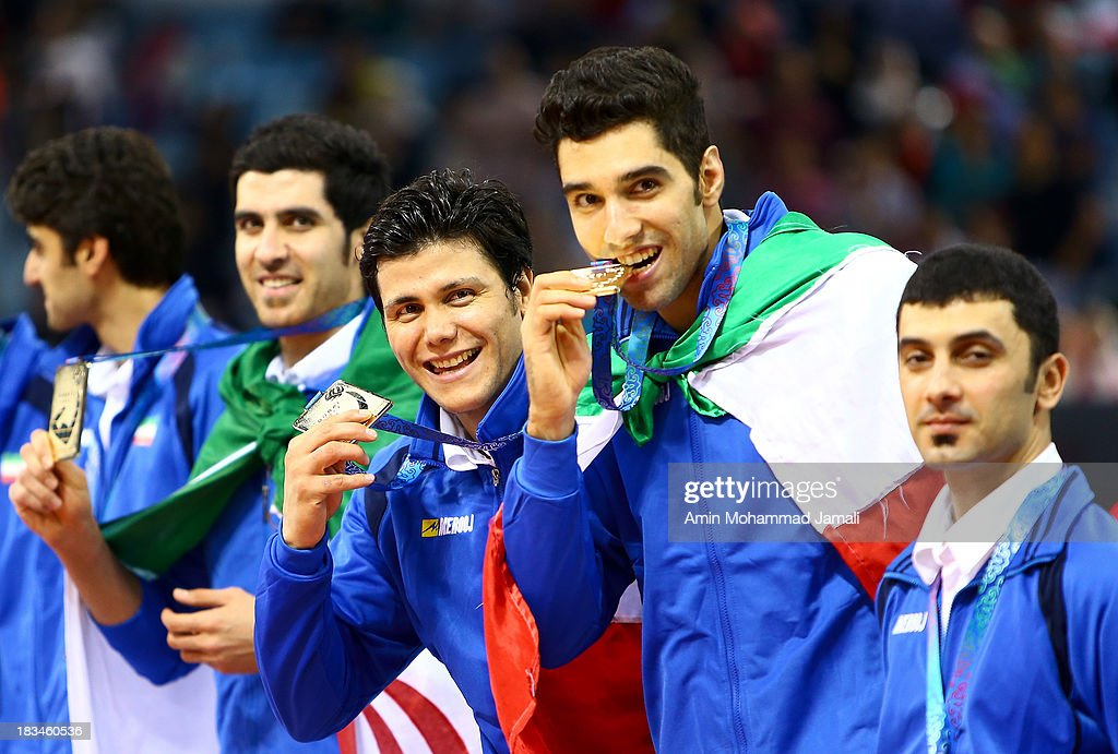 Mehdi Mahdavi (L) and Seyed mohammad Mousavi and Farhad Zarif during 17th Asian Men's Volleyball Championship between Iran And Korea on October 6, 2013 in Dubai, United Arab Emirates.