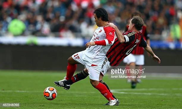 Mehdi Mahdavikia of Perspolis FC and Franco Baresi of AC Milan Glorie battle for the ball during the Perspolis FC v AC Milan Glorie Milan Foundation...