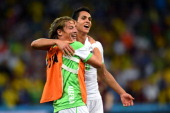 Mehdi Mostefa and Aissa Mandi of Algeria celebrate after a 11 draw during the 2014 FIFA World Cup Brazil Group H match between Algeria and Russia at...