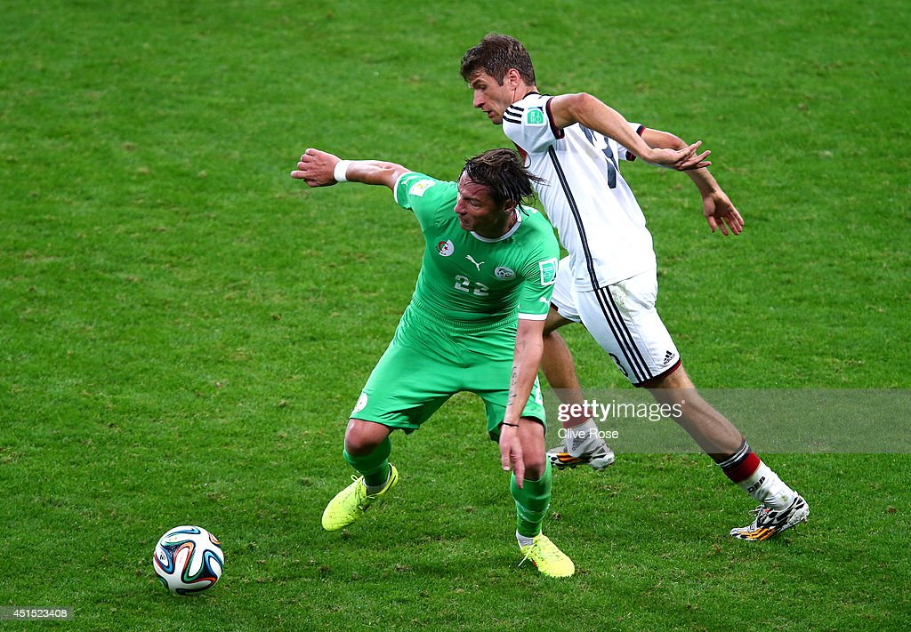 <a gi-track='captionPersonalityLinkClicked' href=/galleries/search?phrase=Mehdi+Mostefa&family=editorial&specificpeople=6328029 ng-click='$event.stopPropagation()'>Mehdi Mostefa</a> of Algeria controls the ball against <a gi-track='captionPersonalityLinkClicked' href=/galleries/search?phrase=Thomas+Mueller&family=editorial&specificpeople=5842906 ng-click='$event.stopPropagation()'>Thomas Mueller</a> of Germany during the 2014 FIFA World Cup Brazil Round of 16 match between Germany and Algeria at Estadio Beira-Rio on June 30, 2014 in Porto Alegre, Brazil.
