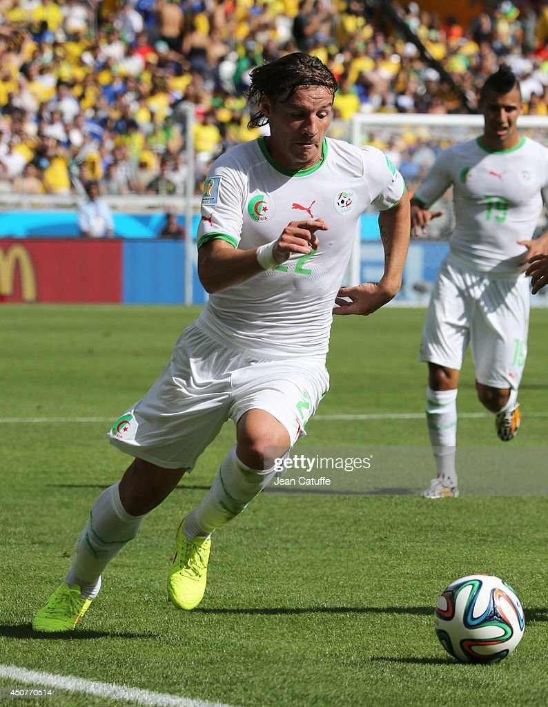 <a gi-track='captionPersonalityLinkClicked' href=/galleries/search?phrase=Mehdi+Mostefa&family=editorial&specificpeople=6328029 ng-click='$event.stopPropagation()'>Mehdi Mostefa</a> of Algeria in action during the 2014 FIFA World Cup Brazil Group H match between Belgium and Algeria at Estadio Mineirao on June 17, 2014 in Belo Horizonte, Brazil.