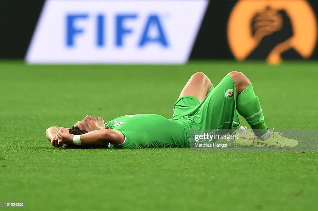 <a gi-track='captionPersonalityLinkClicked' href=/galleries/search?phrase=Mehdi+Mostefa&family=editorial&specificpeople=6328029 ng-click='$event.stopPropagation()'>Mehdi Mostefa</a> of Algeria lies on the field after being defeated by Germany 2-1 during the 2014 FIFA World Cup Brazil Round of 16 match between Germany and Algeria at Estadio Beira-Rio on June 30, 2014 in Porto Alegre, Brazil.