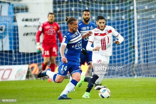 Mehdi Mostefa of Bastia and Yassine Benzia of Lille during the French Ligue 1 match between Bastia and Lille at Stade Armand Cesari on April 1 2017...