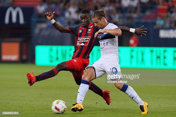 Mehdi Mostefa Sbaa of Bastia and Yann Karamoh of Caen during the French Ligue 1 match between SM Caen an Bastia at Stade Michel D'Ornano on August 27...