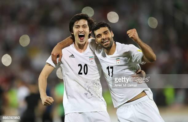 Mehdi Taremi and Sardar Azmoun celebrate after the match during FIFA 2018 World Cup Qualifier match between Iran and Uzbekistan at Azadi Stadium on...