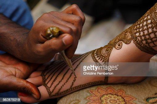 Mehndi Ceremony Caption : Mehendi or henna ceremony before an indian wedding stock