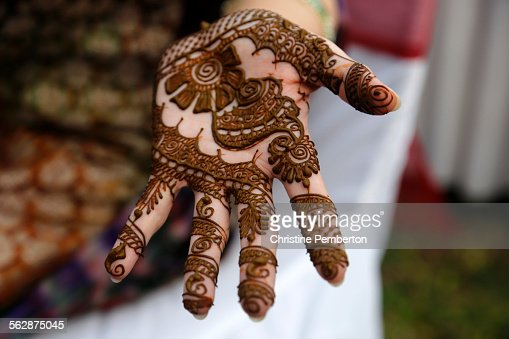 Mehendi Ceremony S : Mehendi or henna ceremony before an indian wedding stock