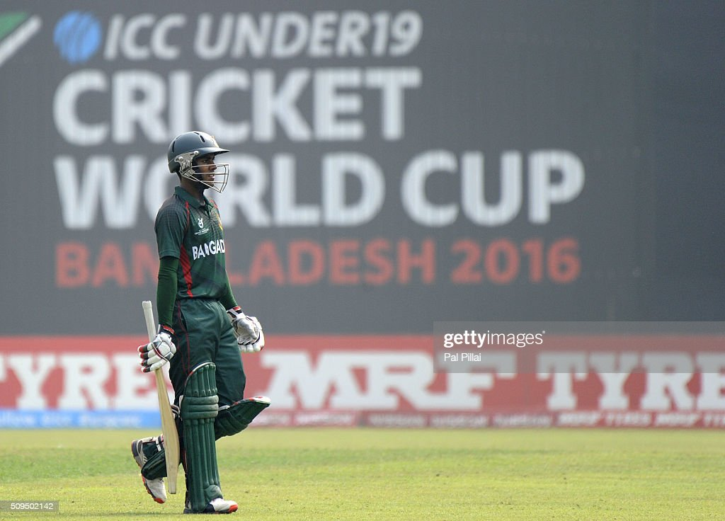 MD Mehidy Hassan Miraz of Bangladesh U19 walks back after getting out during the ICC U 19 World Cup Semi-Final match between Bangladesh and West Indies on February 11, 2016 in Dhaka, Bangladesh.