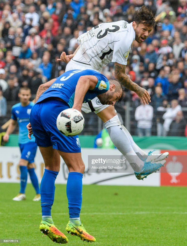 Mehmedalija Covic of TuS Erndtebrueck challenges Marco Russ of Eintracht Frankfurt during the DFB Cup match between TuS Erndtebrueck and Eintracht Frankfurt at Leimbachstadion on August 12, 2017 in Siegen, Germany.