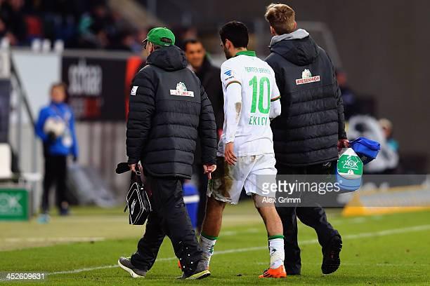 Mehmer Ekici of Bremen is led off the pitch during the Bundesliga match between 1899 Hoffenheim and Werder Bremen on November 30 2013 in Sinsheim...