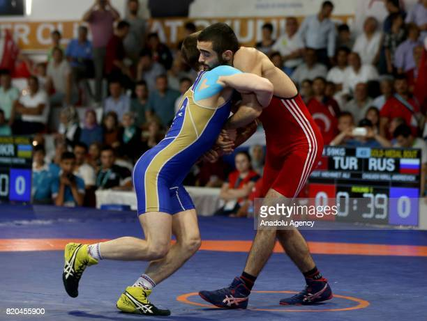 Mehmet Ali Yigit of Turkey in action against Kirill Andreevich Chulkov of Russia during men's 59 kg grecoroman wrestling within the 23rd Summer...
