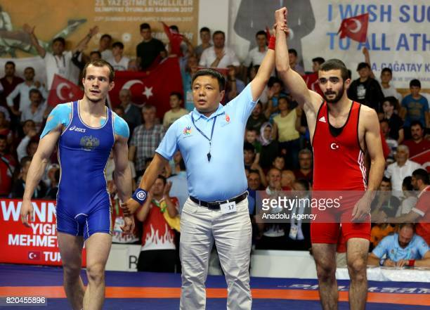 Mehmet Ali Yigit of Turkey wins against Kirill Andreevich Chulkov of Russia in men's 59 kg grecoroman wrestling within the 23rd Summer Deaflympics...