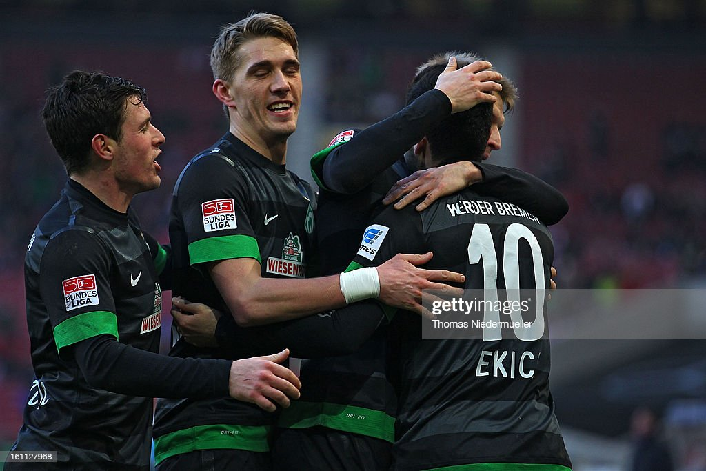Mehmet Ekici (R) of Bremen celebrates his goal during the Bundesliga match between VfB Stuttgart and Werder Bremen at Mercedes-Benz Arena on February 9, 2013 in Stuttgart, Germany.