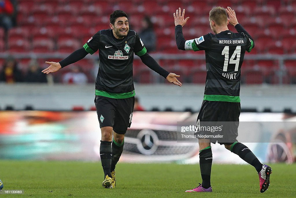 Mehmet Ekici (L) of Bremen celebrates his goal with Aaron Hunt (R) of Bremen during the Bundesliga match between VfB Stuttgart and Werder Bremen at Mercedes-Benz Arena on February 9, 2013 in Stuttgart, Germany.