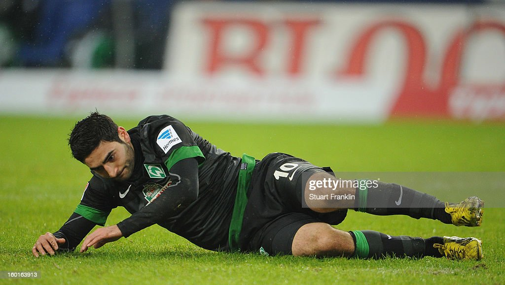 <a gi-track='captionPersonalityLinkClicked' href=/galleries/search?phrase=Mehmet+Ekici&family=editorial&specificpeople=4379088 ng-click='$event.stopPropagation()'>Mehmet Ekici</a> of Bremen looks dejected during the Bundesliga match between Hamburger SV and SV Werder Bremen at Imtech Arena on January 27, 2013 in Hamburg, Germany.