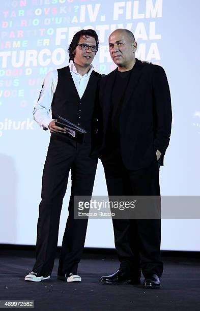 Mehmet Gunsur and Ferzan Ozpetek attend the Turkish Film Festival of Rome at Cinema Barberini on April 16 2015 in Rome Italy