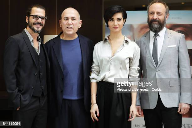 Mehmet Gunsur Director Ferzan Ozpetek Tuba Buyukustun and Halit Ergenc attend the Photocall of movie Rosso Istanbul on February 23 2017 in Rome Italy