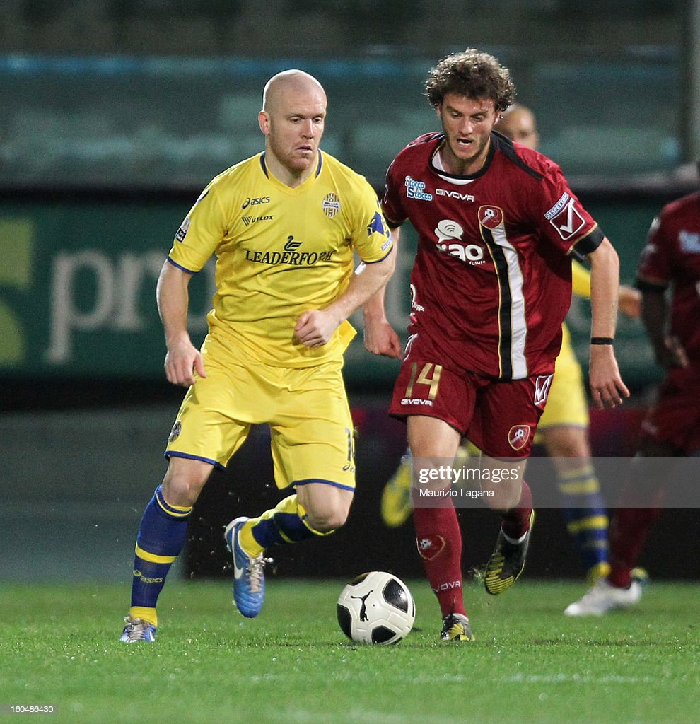 Mehmet Hetenaj (R) of Reggina competes for the ball with Emil Halfredsson of Verona during the Serie B match between Reggina Calcio and Hellas Verona at Stadio Oreste Granillo on February 1, 2013 in Reggio Calabria, Italy.