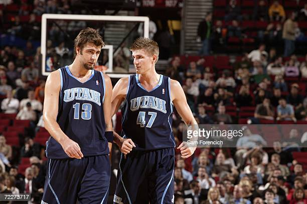 Mehmet Okur and Andrei Kirilenko of the Utah Jazz take the court during a preseason game against the Portland Trail Blazers at the Rose Garden on...