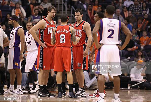 Mehmet Okur Deron Williams and Kris Humphries of the New Jersey Nets during the NBA game against the Phoenix Suns at US Airways Center on January 13...