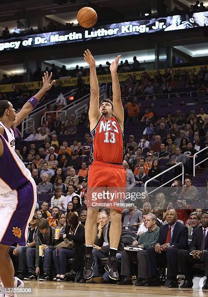 Mehmet Okur of the New Jersey Nets puts up a shot during the NBA game against the Phoenix Suns at US Airways Center on January 13 2012 in Phoenix...