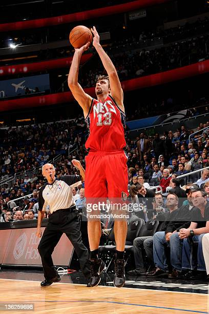 Mehmet Okur of the New Jersey Nets shoots against the Orlando Magic during the game on December 29 2011 at Amway Center in Orlando Florida NOTE TO...