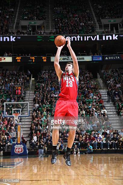 Mehmet Okur of the New Jersey Nets takes a shot inside the 3 point line at Energy Solutions Arena on January 14 2012 in Salt Lake City Utah NOTE TO...