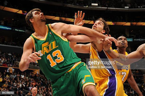 Mehmet Okur of the Utah Jazz boxes out against Pau Gasol of the Los Angeles Lakers at Staples Center on December 9 2009 in Los Angeles California...