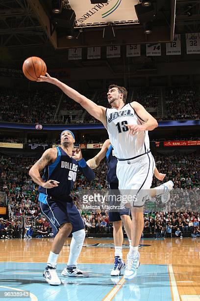 Mehmet Okur of the Utah Jazz goes up for the layup against Drew Gooden of the Dallas Mavericks at EnergySolutions Arena on February 1 2010 in Salt...