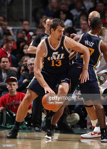 Mehmet Okur of the Utah Jazz handles the ball during a game against the Milwaukee Bucks on December 18 2010 at the Bradley Center in Milwaukee...