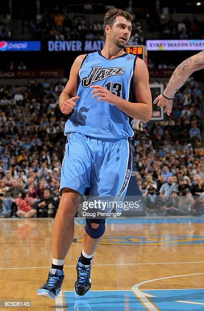 Mehmet Okur of the Utah Jazz heads down court against the Denver Nuggets during NBA action at Pepsi Center on October 28 2009 in Denver Colorado The...