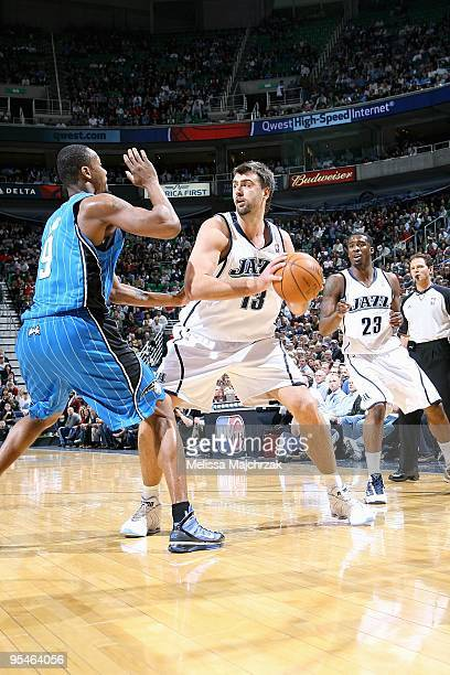 Mehmet Okur of the Utah Jazz looks to pass over Rashard Lewis of the Orlando Magic during the game on December 10 2009 at EnergySolutions Arena in...