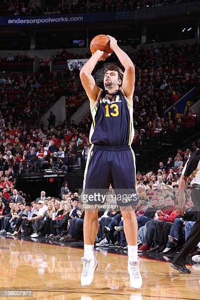 Mehmet Okur of the Utah Jazz shoots against the Portland Trail blazers during the preseason game on December 19 2011 at the Rose Garden Arena in...