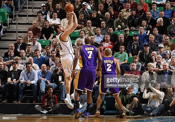 Mehmet Okur of the Utah Jazz shoots over Lamar Odom and Derek Fisher of the Los Angeles Lakers during the game on February 10 2010 at EnergySolutions...