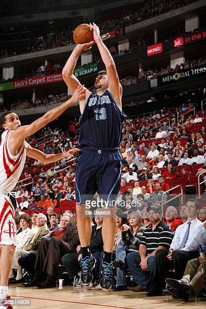 Mehmet Okur of the Utah Jazz shoots the ball over Kevin Martin of the Houston Rockets on April 7 2010 at the Toyota Center in Houston Texas NOTE TO...
