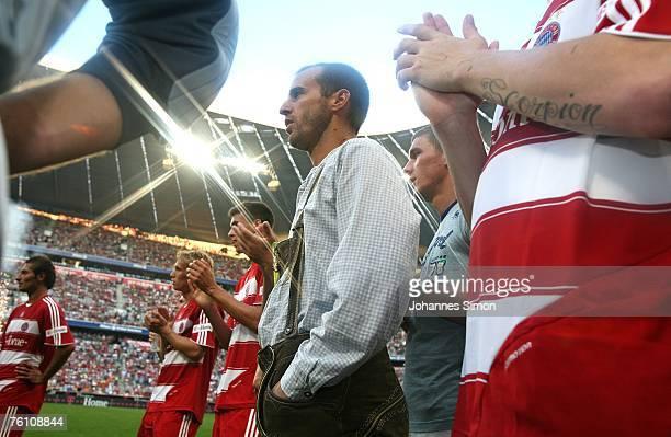 Mehmet Scholl of Bayern Munich looks on after the Franz Beckenbauer Cup match between Bayern Munich and Barcelona at the Allianz Arena on August 15...